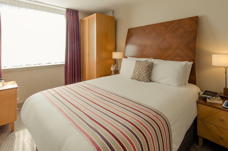 Double bed at Premier Suites Manchester
