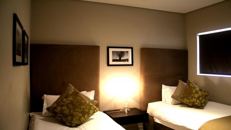 Twin bedroom at Genesis Suites