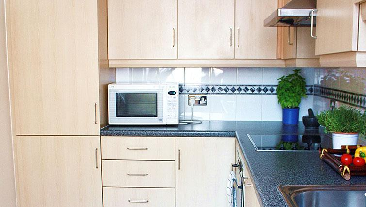 Equipped kitchen at Astral House Apartments