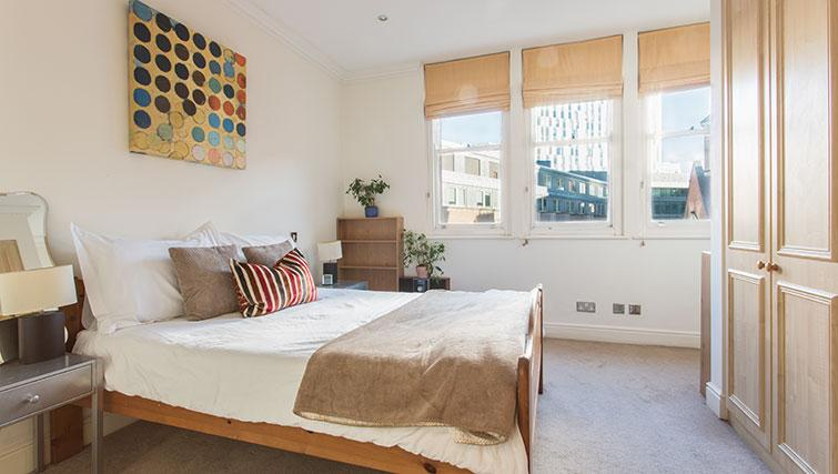 Bed at Astral House Apartments
