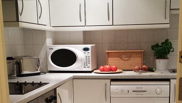 Well equipped kitchen at Astral House Apartments
