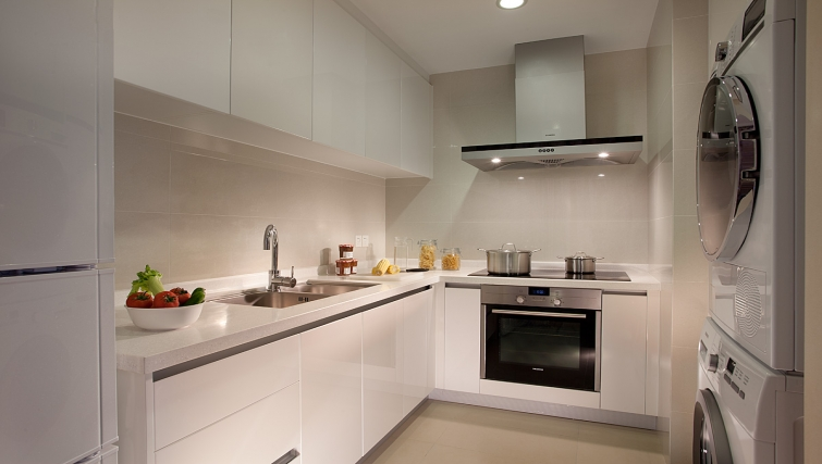 Fully equipped kitchen at Ascott Midtown Suzhou Apartments