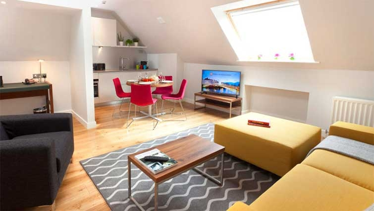 Open-plan living area at Premier Suites Dublin Ballsbridge