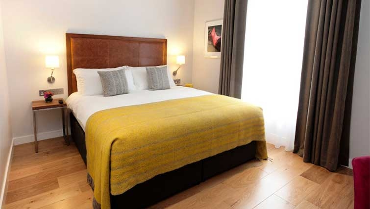 Double bedroom at Premier Suites Dublin Ballsbridge