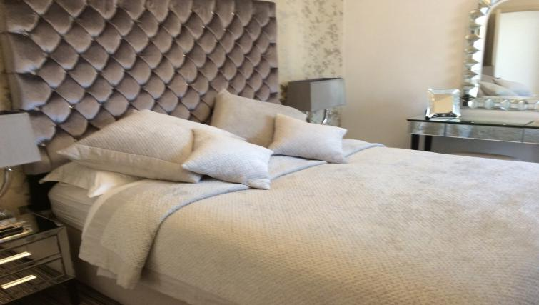 Double bed at Straw House Apartments