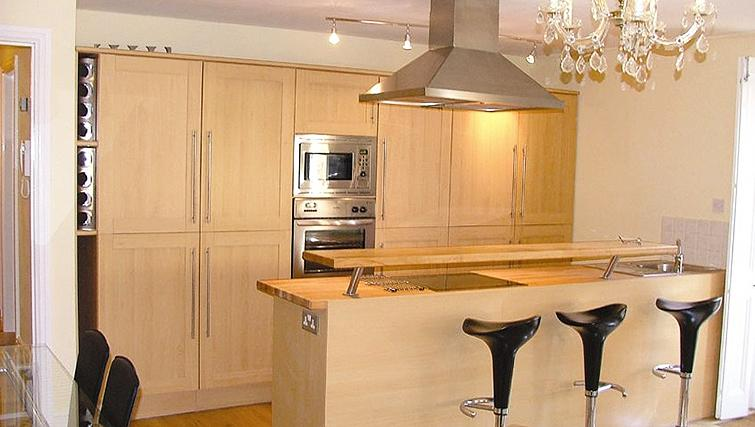 Compact kitchen in Straw House Apartments