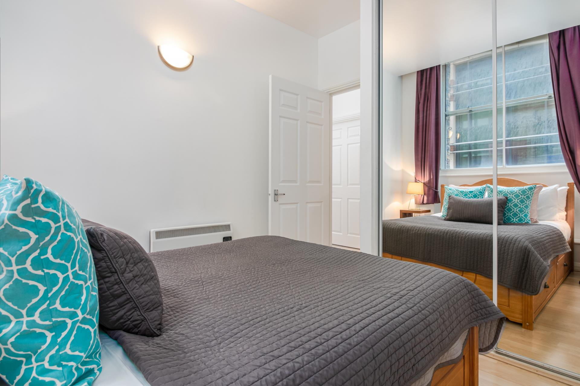 Bed at Priory House Apartments, City, London