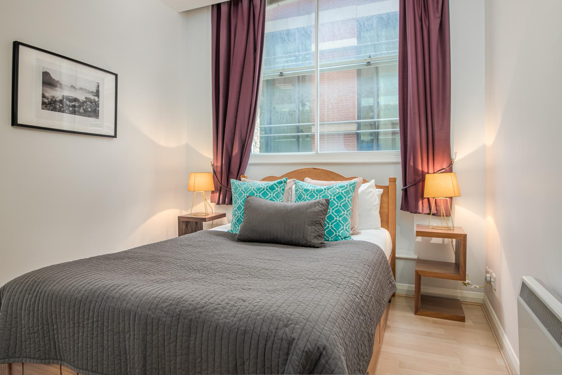 Bright bedroom at Priory House Apartments, City, London