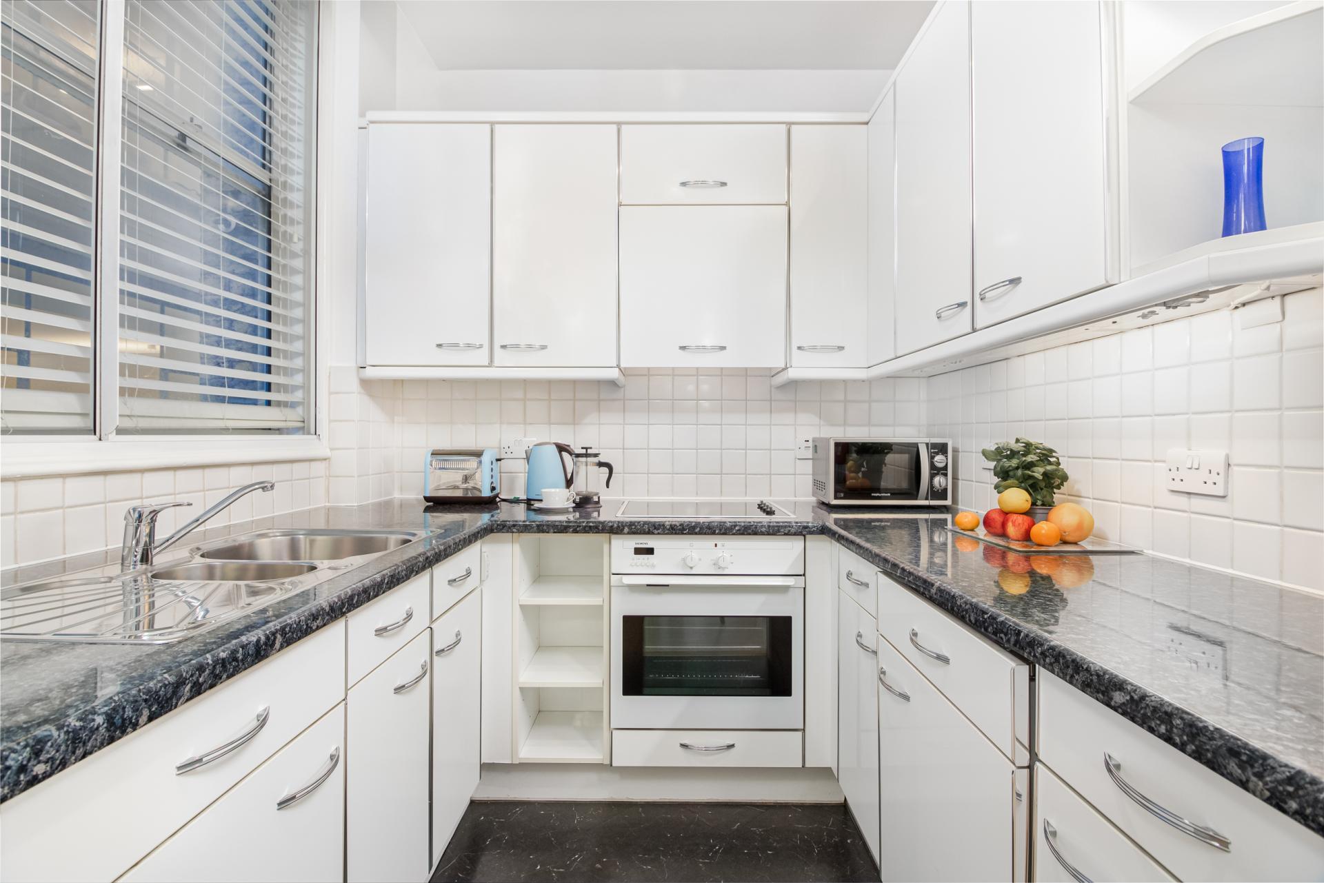 Sleek kitchen at Priory House Apartments, City, London