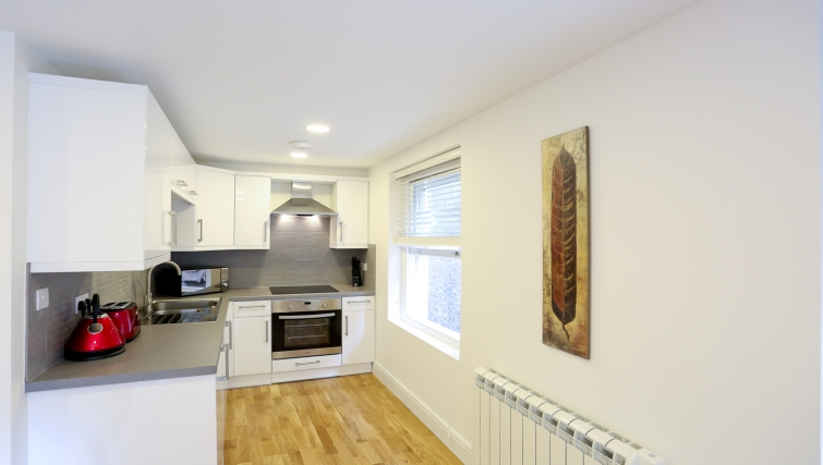 Fully equipped kitchen at Fleet Street Studio Apartments