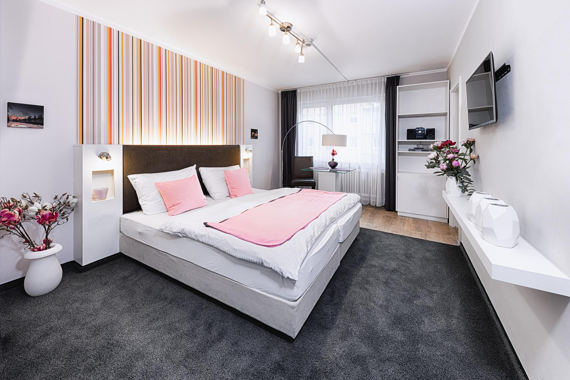 Minimal bedroom at Boardinghouse Serviced Apartments