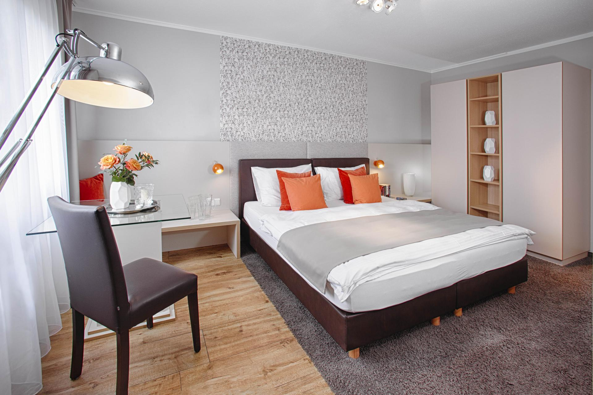 Bright bedroom at Boardinghouse Serviced Apartments