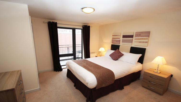 Cosy bedroom at Baltic Quays Apartments
