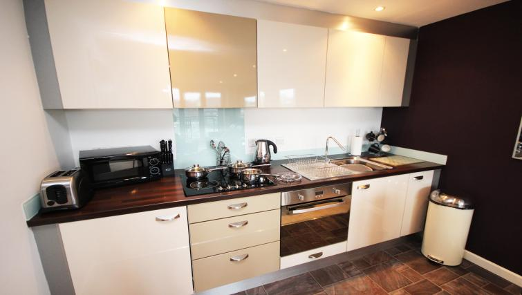 Equipped kitchen at City Quadrant Apartments