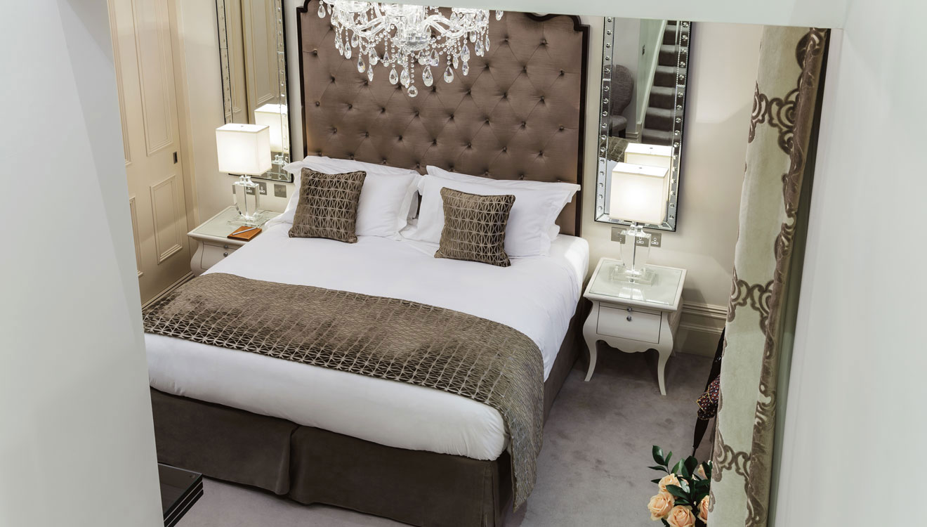 Cosy bedroom at The Apartments by The Sloane Club