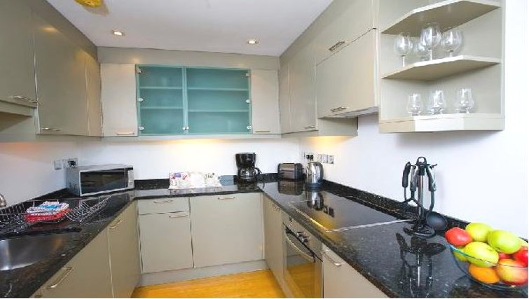 Modern kitchen in Oakwood Monument Street Apartments