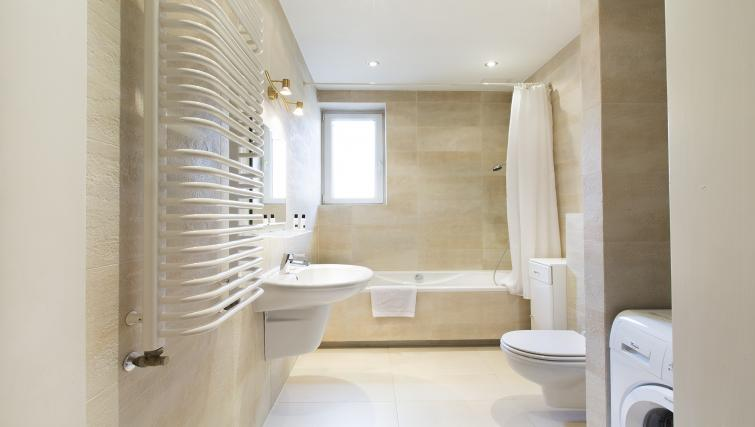 Immaculate bathroom at Michalowskiego Street Apartment
