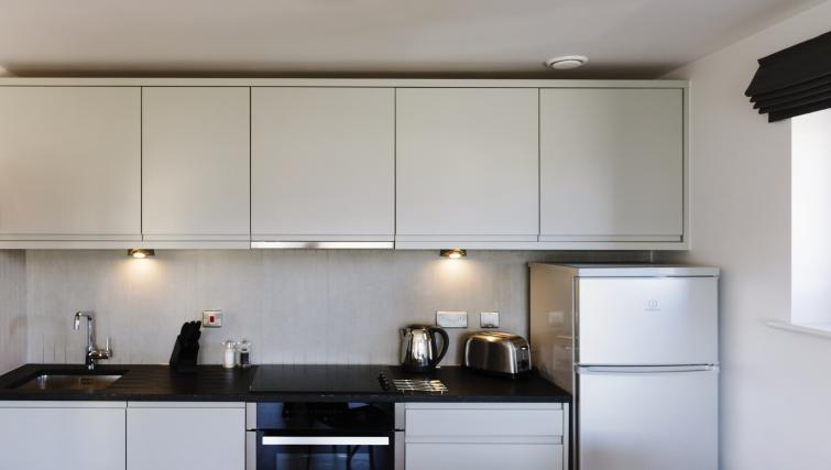 Fully equipped kitchen at Eden House Apartments