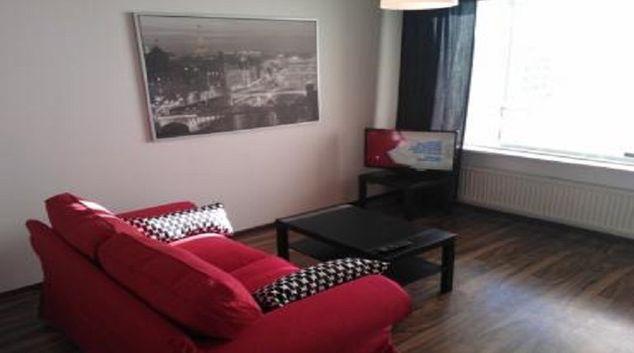 Living room in Lansipuisto Apartment