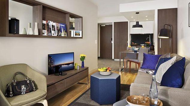 Open-plan living area at Citadines Michel Hamburg Apartments