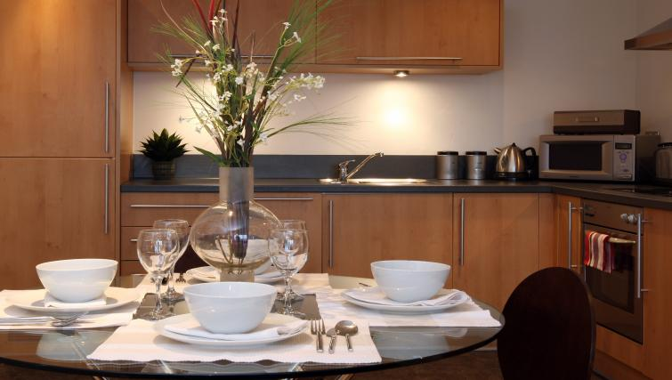 Dining table at The Chambers Riverside West Apartments