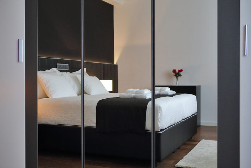 Modern bedroom at Villa Medici Apartments