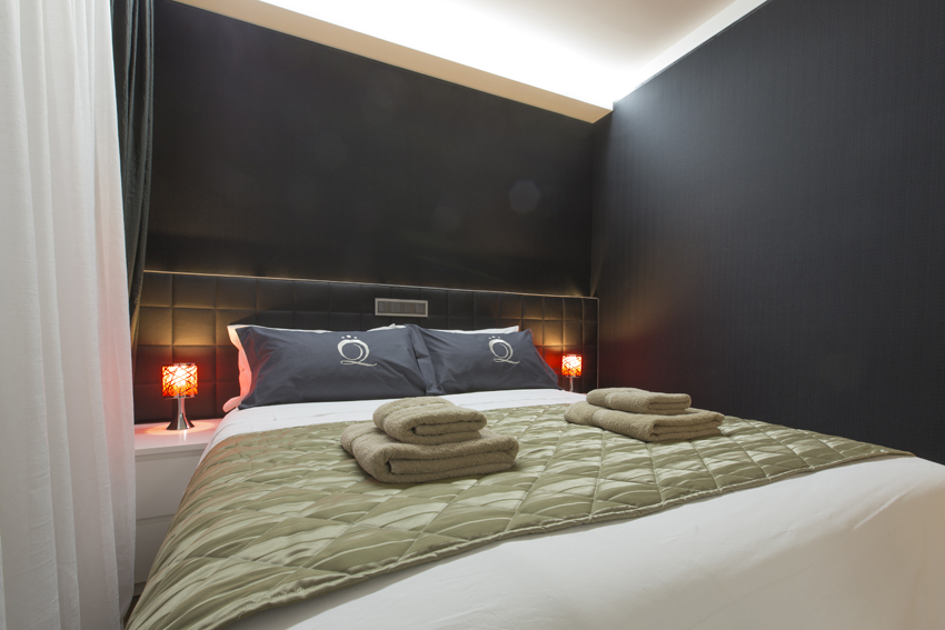 Stylish bedroom at Villa Medici Apartments