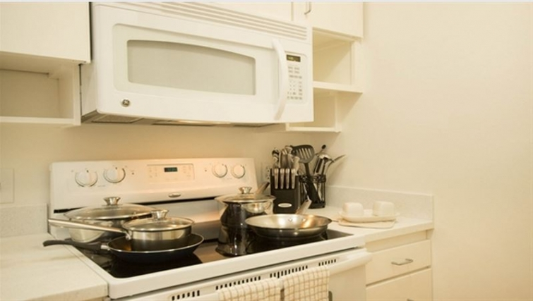 Fully equipped kitchen at Gateway Apartment