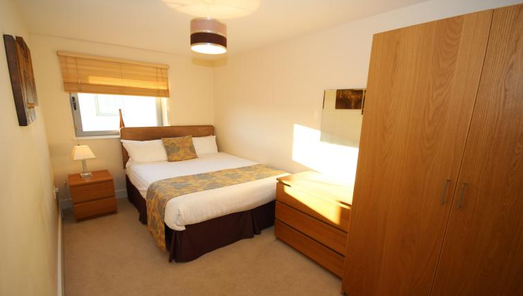Comfy bedroom at Lime Square Apartments