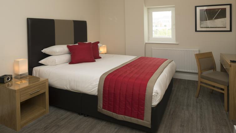 Bed at Beneficial House Apartments