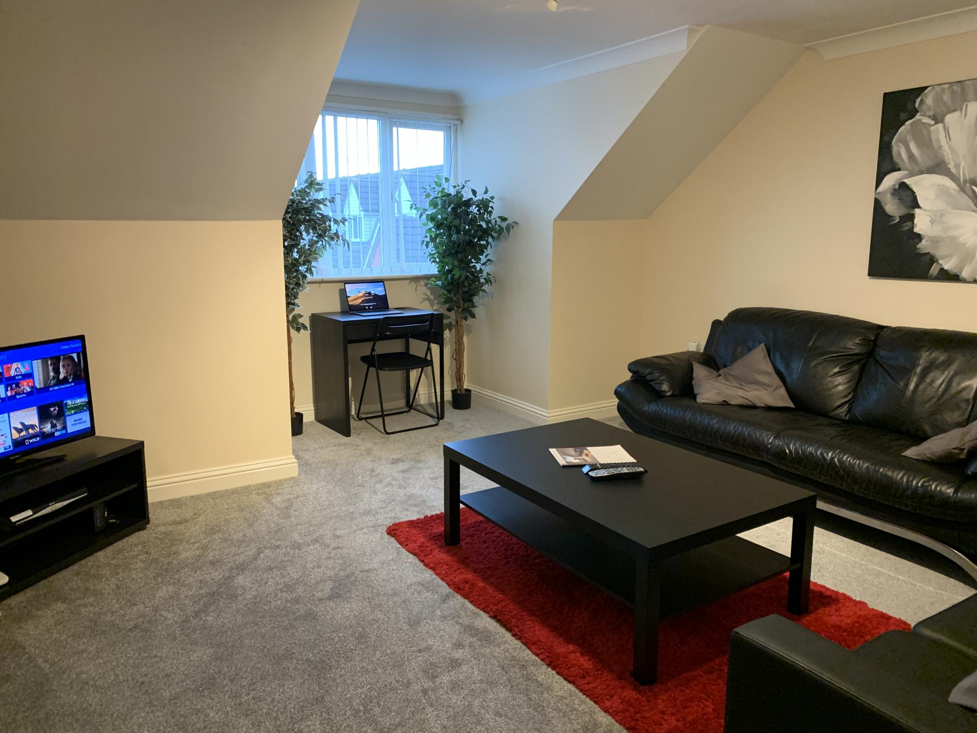 Compact living area in Peterhouse Close Apartments