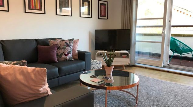Living room at St Andrew Square Apartments