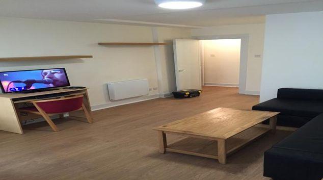 Spacious living area at Smithfield Village Apartments