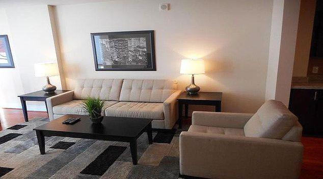 Living area at Weichert Suites Avenue Apartments