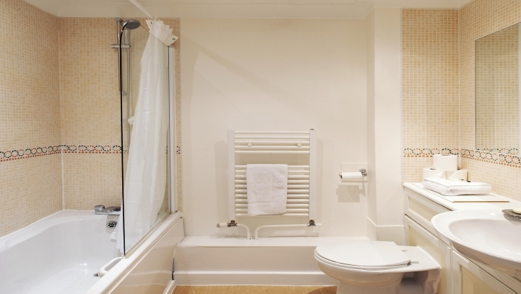Neat bathroom with a bath at Market Rise Apartments