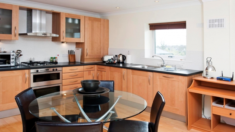 Contemporary kitchen & dining area at Market Rise Apartments