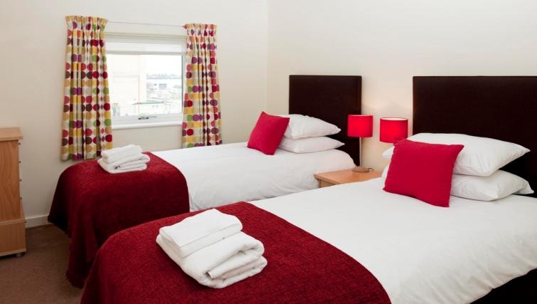 Vibrant bedroom at Market Rise Apartments