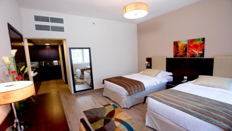 Bedroom and twin beds at Links Hotel Apartments