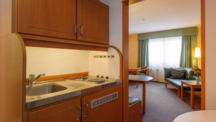 Kitchen at Wings Boardinghouse Apartments