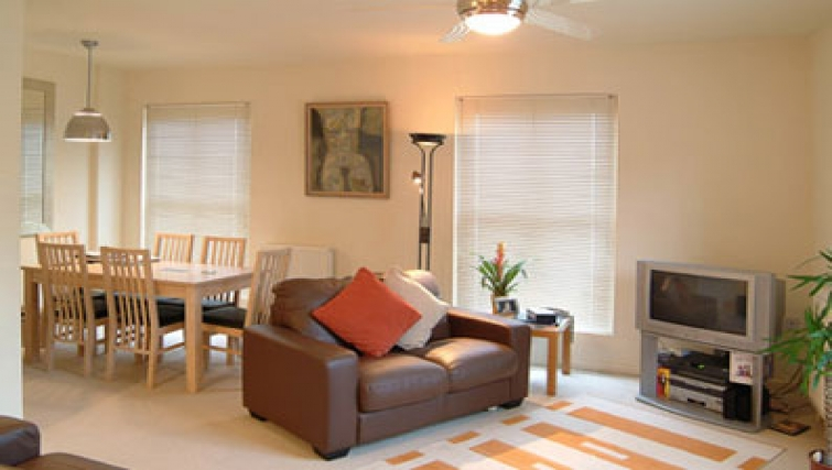 Living/dining area at Golden Triangle Apartments