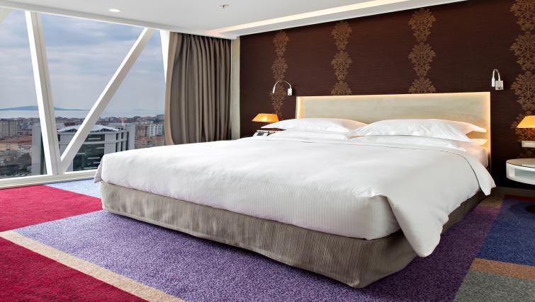 Comfy bedroom at Burgu Arjaan Apartments