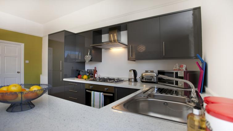 Equipped kitchen at The Mezzo Apartment