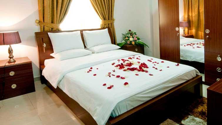 Bedroom at La Villa Inn Apartments