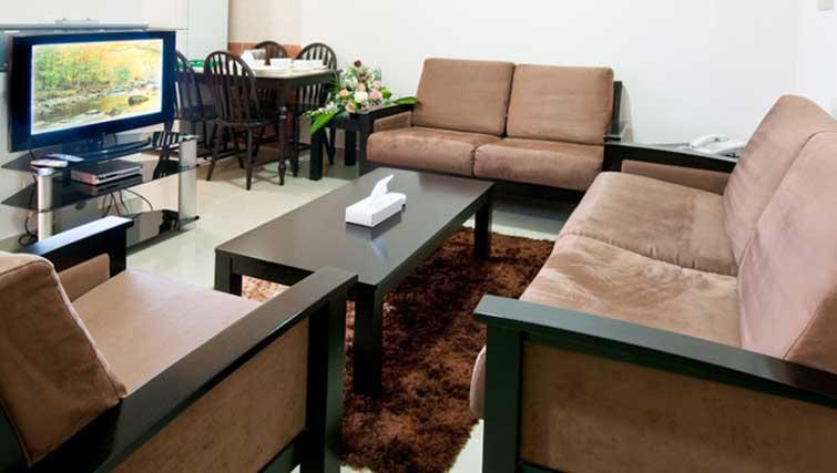 Living/dining area at La Villa Inn Apartments