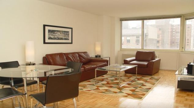 Living room at ABA Archstone Midtown West Apartments