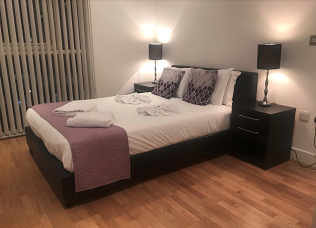 Double bed at Still Life Tower Hill Deluxe