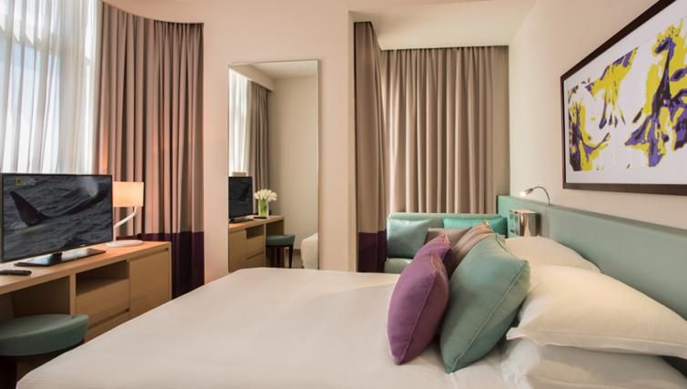 Double bed at Capital Centre Arjaan Apartments