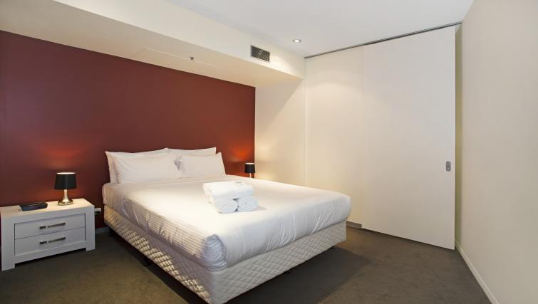 Comfortable bed at Astra Apartments Melbourne CBD