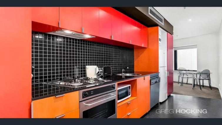 Equipped kitchen at Astra Apartments Melbourne CBD