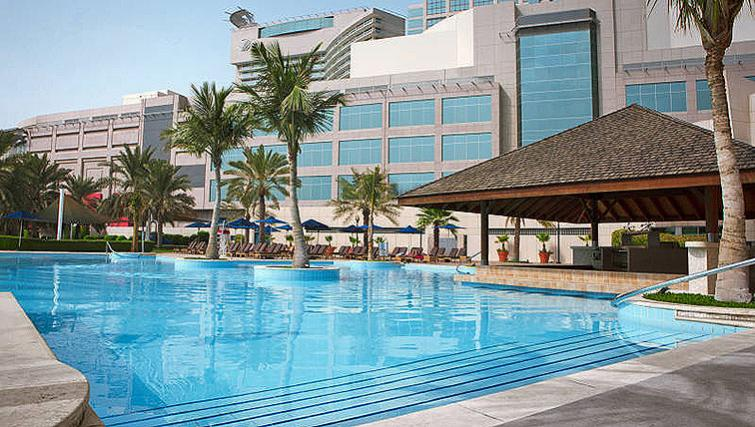 Tranquil pool at Beach Rotana All Suites